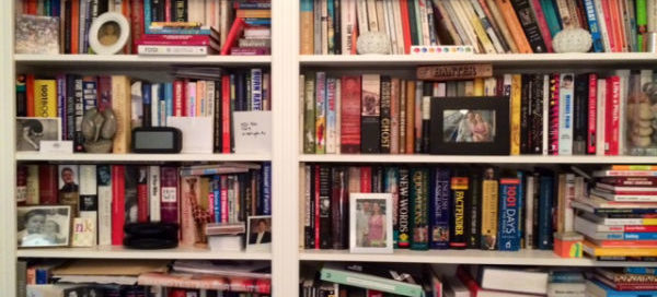 One of the overstacked floor-to-ceiling bookshelves in my London flat