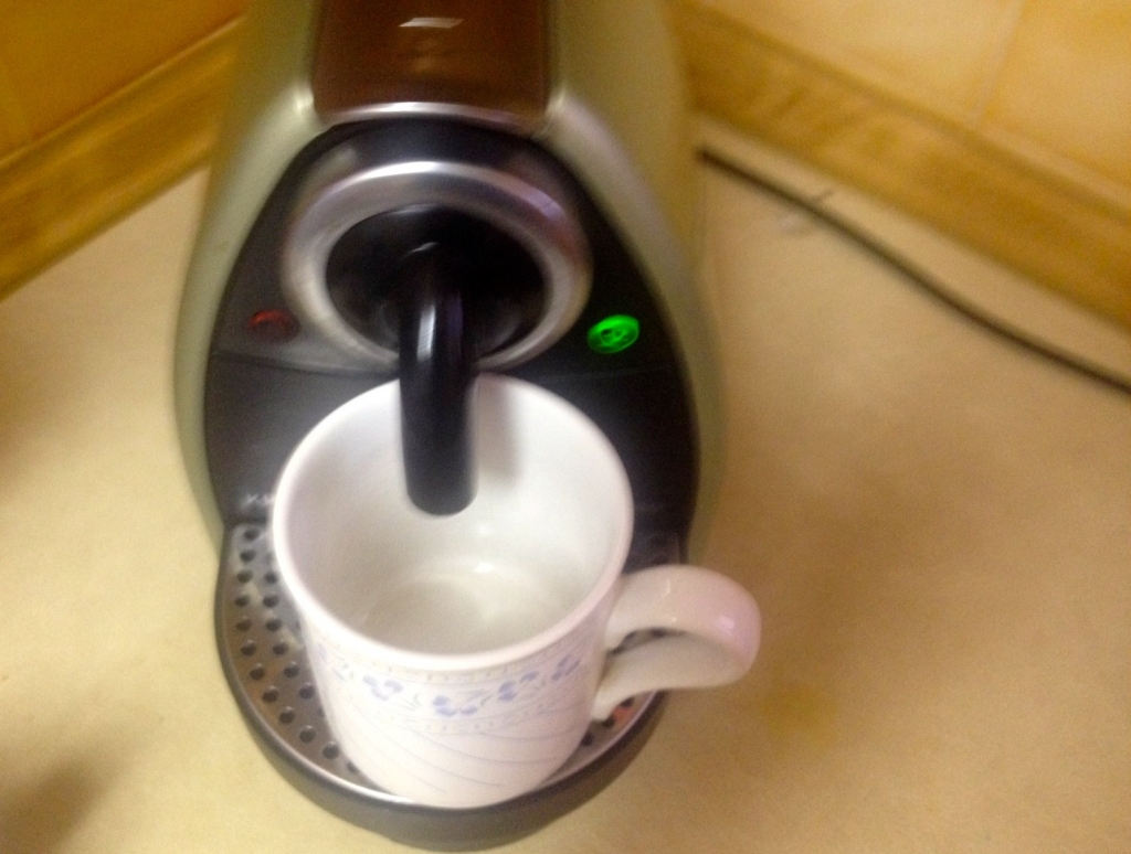 Press the green button to start filtering the coffee