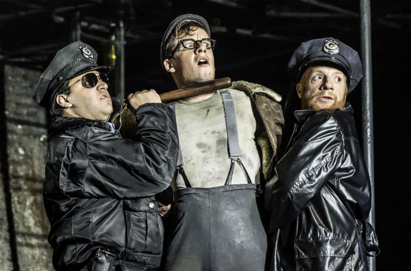 Nathan Amzi, Matthew Seadon-Young and Jonathan Slinger in Urinetown at the Apollo Theatre, West End, London