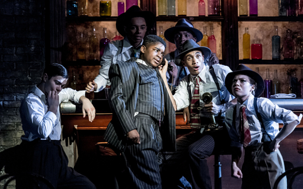 James Okulaja as Fat Sam, with his gang, in Bugsy Malone at the Lyric Hammersmith.