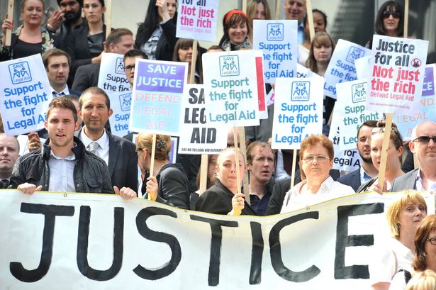 Solicitors, barristers and other campaigners have gone on strike against UK legal aid cuts